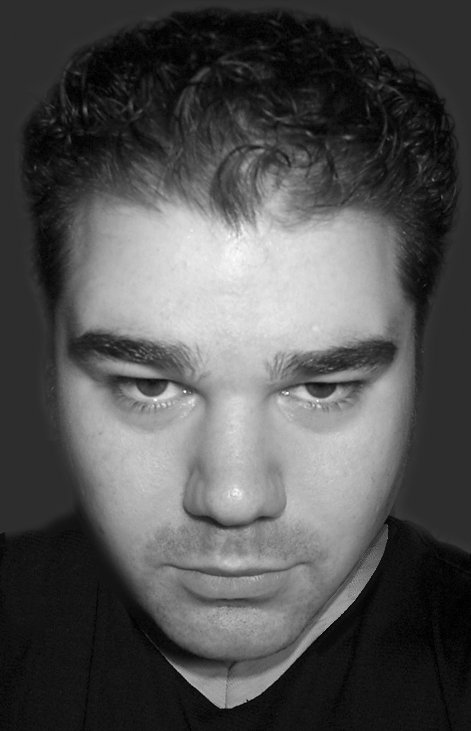 Speaking of scruffy, my headshot for the panto program.